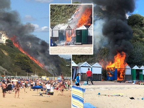 Beach evacuated after cliff face catches fire 'from cooking stove in hut'