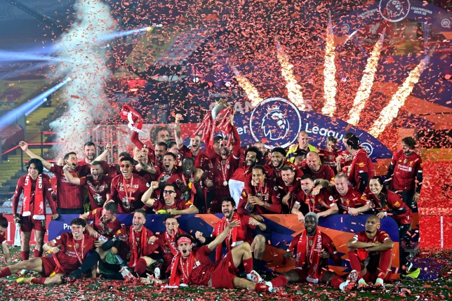 LIVERPOOL, ENGLAND - JULY 22: Jordan Henderson of Liverpool lifts The Premier League trophy surrounded by his teammates following the Premier League match between Liverpool FC and Chelsea FC at Anfield on July 22, 2020 in Liverpool, England