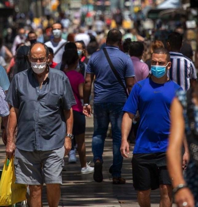 People wearing face masks in Spain