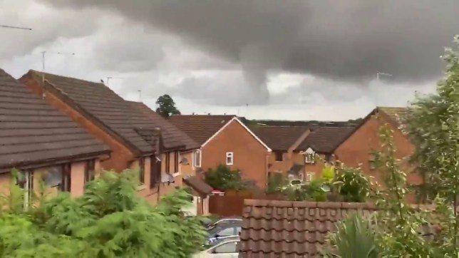 Tornado over Northampton. See SWNS copy SWMDtornado: Dramatic images show the aftermath of a TORNADO which tore through a town causing thousands of pounds of damage to homes and allotments. The twister touched down in Northampton at around 8pm on Saturday (25/7) as high winds and storms battered the area. Shocking footage shows the tornado ripping through the north side of the East Midlands town flinging debris into the air. Gardeners at Moulton Allotments were left counting the cost as entire sheds were overturned and fence panels lifted from the ground.