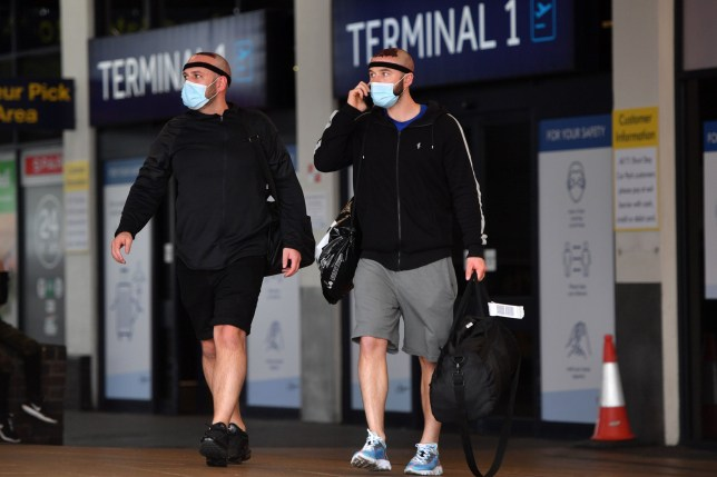 Passengers at manchester airport in face masks