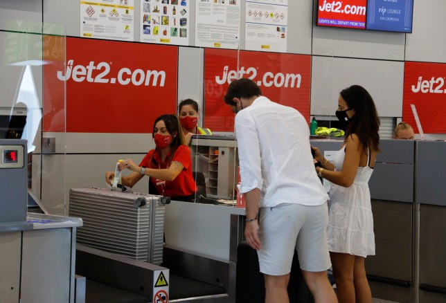 Customers at a Jet2 counter in an airport