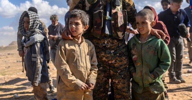 Children believed to be from the Yazidi community, who were captured by Islamic State (IS) group fighters, are pictured after being evacuated from the IS' embattled holdout of Baghouz,