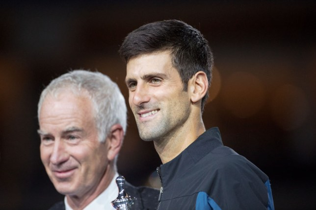 Novak Djokovic of Serbia with John McEnroe at the trophy presentations after his victory against Juan Martin Del Potro of Argentina in the Men's Singles Final on Arthur Ashe Stadium at the 2018 US Open Tennis Tournament at the USTA Billie Jean King National Tennis Center on September 9th, 2018 in Flushing, Queens, New York City.