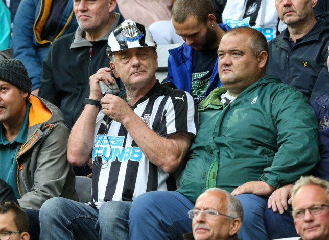 A Newcastle United fan watches on during the Premier League match between Newcastle United and Arsenal FC at St. James Park on August 11, 2019 in Newcastle upon Tyne, United Kingdom.