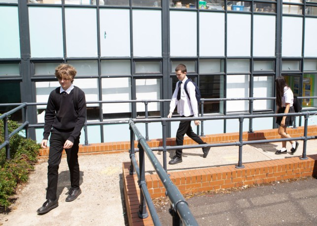 students observing social distancing as they return to school in essex