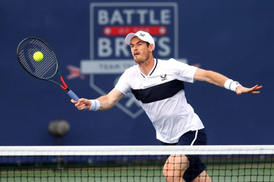 Andy Murray, partner of Naomi Broady of Union Jacks plays a forehand in their mixed doubles match against Emma Raducanu and Kyle Edmund of British Bulldogs during day seven of the St. James's Place Battle Of The Brits Team Tennis at National Tennis Centre on August 02, 2020 in London, England.