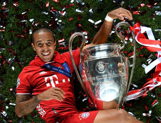 Liverpool transfer target Thiago Alcantara celebrates with the Champions League trophy after Bayern Munich beat PSG