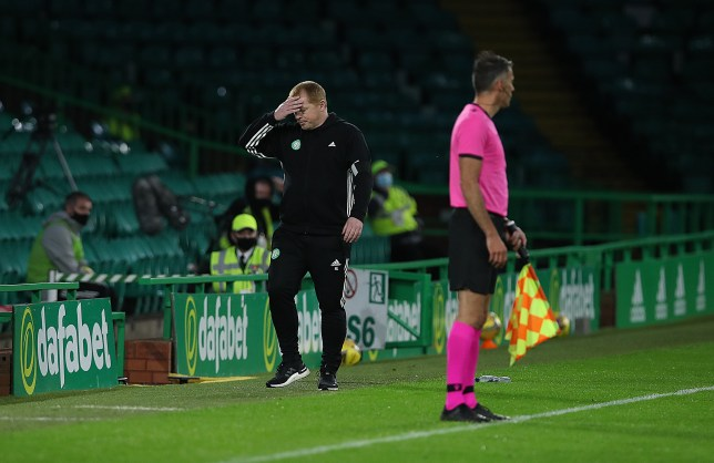 Neil Lennon looks dejected after Celtic's Champions League exit to Ferencvaros