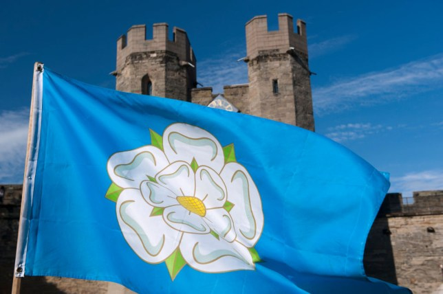 White Rose flag flying at Warwick Castle, associated with the War of the Roses.