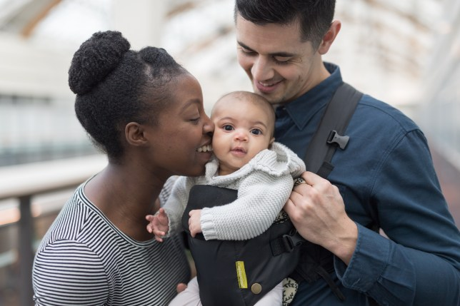 Adoring parents with their baby in a shopping mall