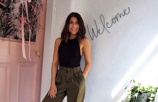 kim mcfarlane standing outside her renovated home