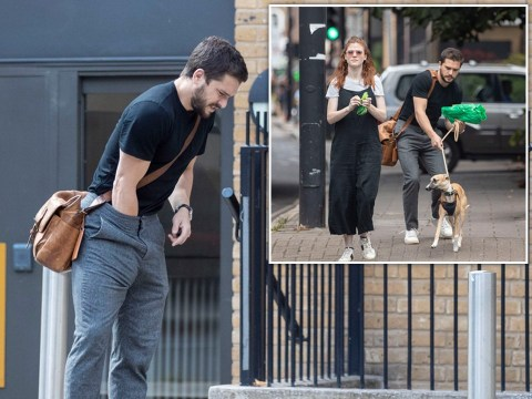 Kit Harington stops to readjust his throne during walk with wife Rose Leslie