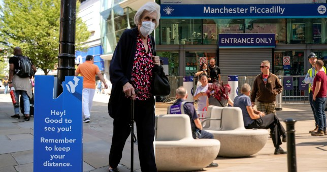 People in face masks at Manchester Piccadilly