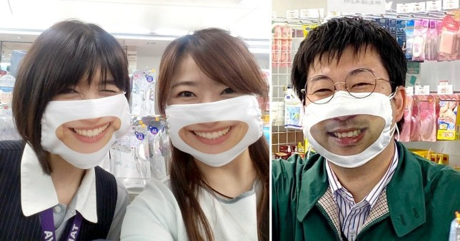 Some of the staff wearing the smile masks