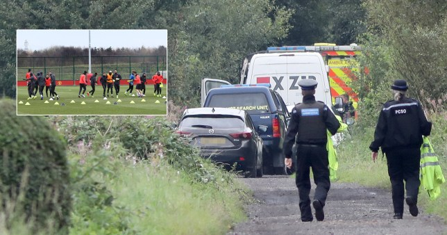 The body of a man in his 20s has been found in woodland close to the Manchester United training ground, in Carrington.