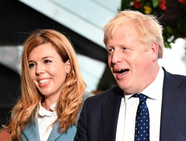 Prime Minister Boris Johnson and his girlfriend Carrie Symonds arrive at the Conservative Party Conference on September 28, 2019 in Manchester, England. Despite Parliament voting against a government motion to award a recess, Conservative Party Conference still goes ahead. Parliament will continue with its business for the duration. (Photo by Jeff J Mitchell/Getty Images)