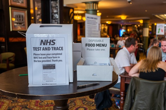 NHS Test and Trace sign in pub
