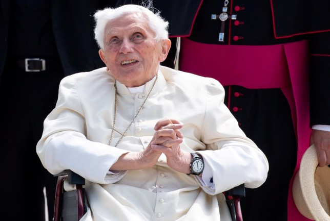 FILE PHOTO: Pope Emeritus Benedict XVI gestures at Munich Airport before leaving for Rome, June 22, 2020. Sven Hoppe/Pool via REUTERS/File Photo