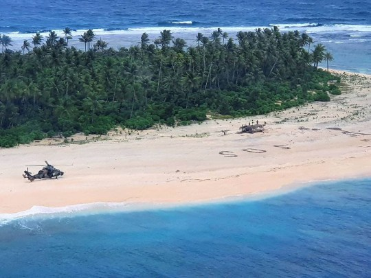 8589779 Stranded sailors are rescued from a tiny Pacific island after their SOS message desperately written in the sand was spotted by Australian pilots - Australian Defence Force