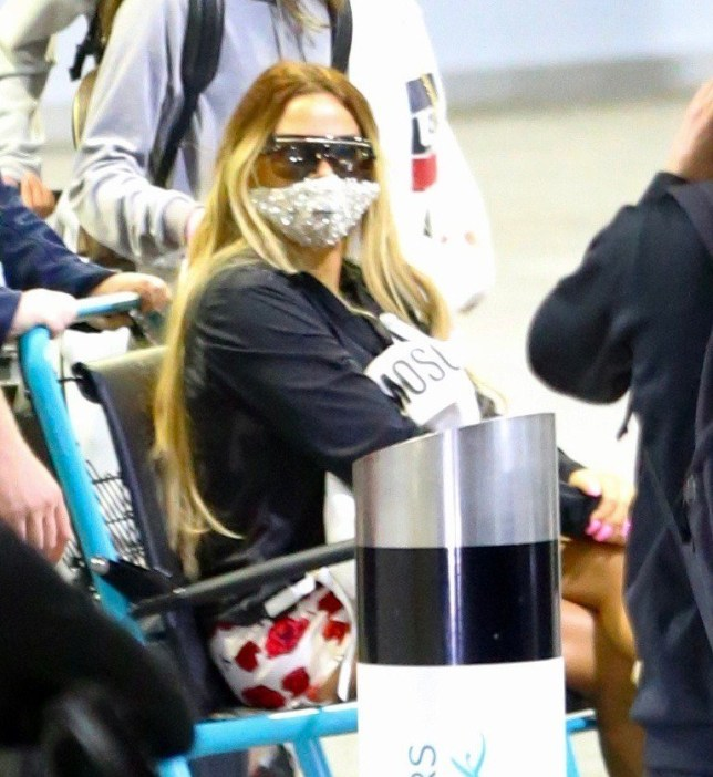 **USE CHILD PIXELATED IMAGES IF YOUR TERRITORY REQUIRES IT** British Reality TV Katie Price pictured arriving back in the UK early this morning. She was seen wearing her face mask and sitting in a wheel chair - Katie damaged her feet while on holiday. Pictured: Katie Price Ref: SPL5180296 050820 NON-EXCLUSIVE Picture by: SplashNews.com Splash News and Pictures USA: +1 310-525-5808 London: +44 (0)20 8126 1009 Berlin: +49 175 3764 166 photodesk@splashnews.com World Rights
