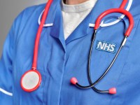 LONDON,ENGLAND - JUNE 6: In this studio shot illustration a NHS uniform close up, with stethoscope on June 6,2019 in London,England. (Photo by Peter Dazeley/Getty Images)