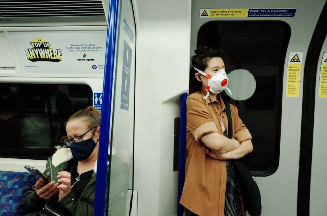 Passengers wearing face masks on the London underground