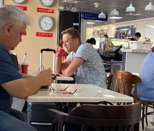 Mr Navalny was photographed drinking from a takeaway cup at the Vienna Cafe at Tomsk airport where he is said to have been poisoned