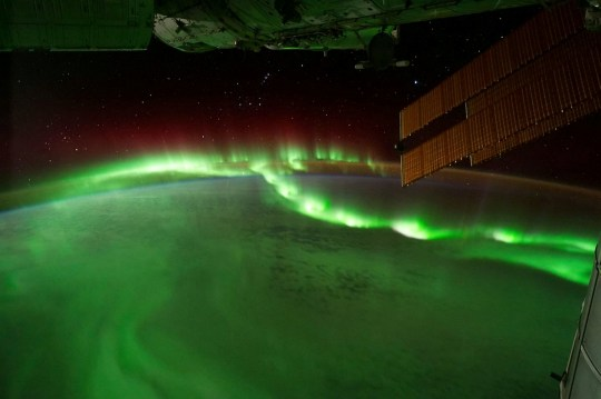 Auroral beads seen from the International Space Station, Sept. 17, 2011. See SWNS story SWNNaurora - A NASA mission has unlocked the mysteries of the phenomenon of space auroras and how they form across the galaxy. A special type of aurora, draped east to west across the night sky like a glowing pearl necklace, is helping researchers better understand the science of auroras and their powerful drivers out in space. Known as auroral beads, these lights often show up just before large auroral displays, which are caused by electrical storms in space called substorms. They are atmospheric phenomenons made up of bands of light caused by charged solar particles following the Earth's magnetic lines of force.