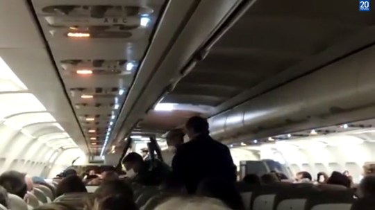 UNCLEARED GRABS: Men escorted off flight to Madrid after not wearing masks