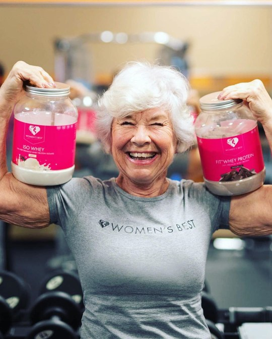 Joan holding up two jars of protein