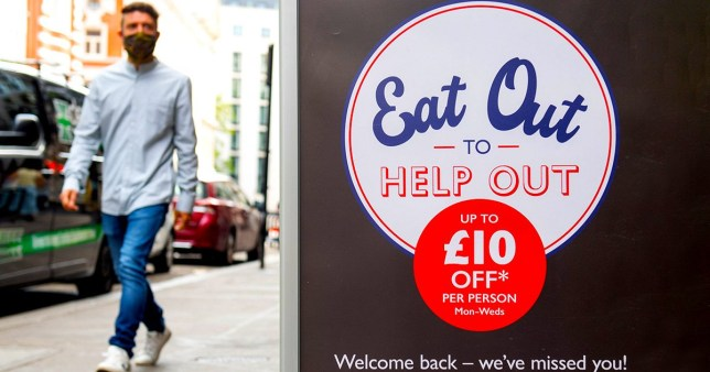 File photo dated 3/8/2020 of a man passing a sign advertising the 'Eat Out to Help Out' scheme, in Covent Garden, London. Just one in 10 adults had participated in the scheme by the middle of August and a third are unlikely to do so, a survey has found. PA Photo. Issue date: Friday August 21, 2020. While 93% of adults told the Office for National Statistics (ONS) they are aware of the scheme, just 11% said they had used it by August 16. See PA story POLITICS EatOut. Photo credit should read: Dominic Lipinski/PA Wire
