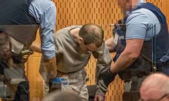 Brenton Tarrant, le tireur qui a tiré et tué des fidèles lors des attaques de la mosquée de Christchurch, est vu lors de sa condamnation à la Haute Cour de Christchurch, Nouvelle-Zélande, le 26 août 2020. John Kirk-Anderson / Pool via REUTERS ATTENTION EDITORS - PARTS OF THE L'IMAGE A ÉTÉ PIXELÉE À LA SOURCE TPX IMAGES DU JOUR