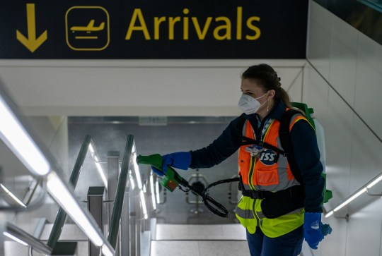 LONDON, ENGLAND - JUNE 09: Cleaners spray a peroxide based disinfectant on handrails and surfaces as a protective measure against the spread of the coronavirus (COVID-19) inside the currently closed North Terminal at Gatwick Airport on June 9, 2020 in London, England. Gatwick Airport has introduced a range of protective measures to battle the spread of the coronavirus (COVID-19) as the airport prepares to increase operating hours from June 15, 2020, and to resume operations at the North Terminal with a range of airlines. The airport???s North Terminal closed in March due to the impact that coronavirus outbreak had on the number of flights able to operate. (Photo by Chris J Ratcliffe/Getty Images)