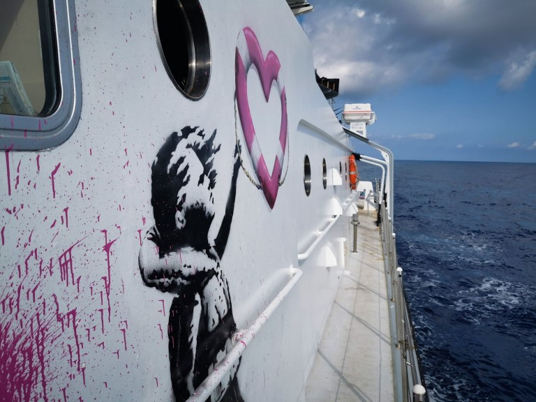 The Louise Michel, a former French navy vessel, launched under its new guise last week and features a painting from Banksy depicting a young girl holding on to a heart-shaped safety float.