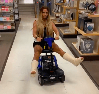 Katie Price on mobility scooter