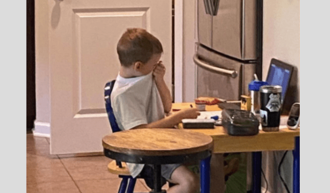 Boy, 5, sobs with frustration while trying to cope with online lessons