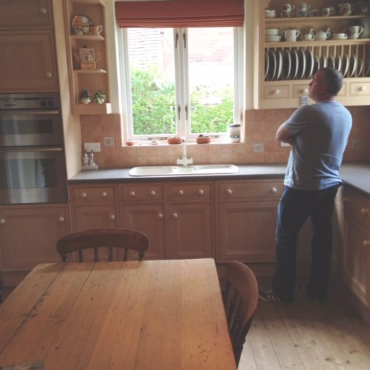 Her husband picking up the kitchen from the previous home