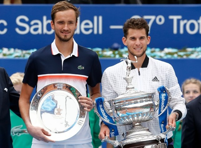 Austria's Dominic Thiem (R) poses with his trophy after defeating Russia's Daniil Medvedev (L) during the ATP Tour Barcelona Open final tennis match in Barcelona on April 28, 2019.