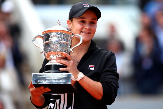 Ashleigh Barty of Australia celebrates victory with the trophy following the ladies singles final against Marketa Vondrousova of The Czech Republic during Day fourteen of the 2019 French Open at Roland Garros on June 08, 2019 in Paris, France.