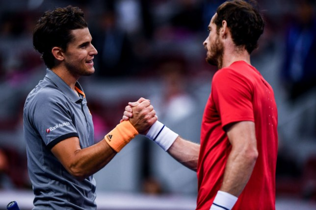 Dominic Thiem (L) of Austria shakes hands with Andy Murray of Great Britain after their Men's Singles quarter-final match on Day seven of 2019 China Open at the China National Tennis Center on October 4, 2019 in Beijing, China.