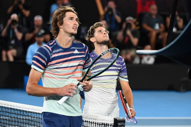 Austria's Dominic Thiem (R) and Germany's Alexander Zverev walk off the court after their men's singles semi-final match on day twelve of the Australian Open tennis tournament in Melbourne on January 31, 2020.