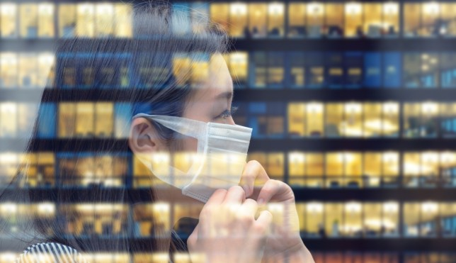 Asian woman with face mask going back to work, business building reflecting