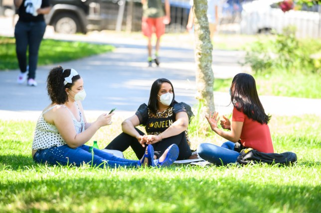 Group of women meeting outside in face masks
