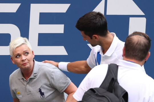 Novak Djokovic of Serbia tends to a line judge who was hit with the ball during his Men's Singles fourth round match against Pablo Carreno Busta of Spain on Day Seven of the 2020 US Open at the USTA Billie Jean King National Tennis Center on September 6, 2020 in the Queens borough of New York City.