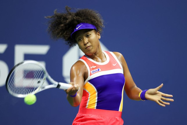 Naomi Osaka of Japan returns the ball during her Women's Singles semifinal match against Jennifer Brady of the United States on Day Eleven of the 2020 US Open at the USTA Billie Jean King National Tennis Center on September 10, 2020 in the Queens borough of New York City