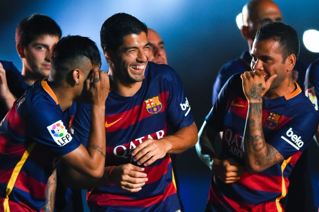 Neymar, Luis Suarez and Dani Alves share a joke during Barcelona's clash with Roma