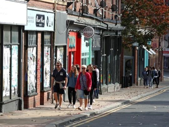 People walk along a high street