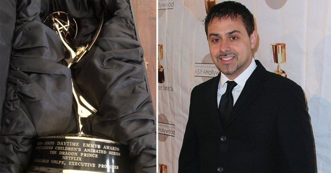 Giancarlo Volpe pictured alongside Emmy Award