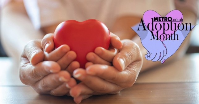 A pair of hands holding a heart-shaped toy